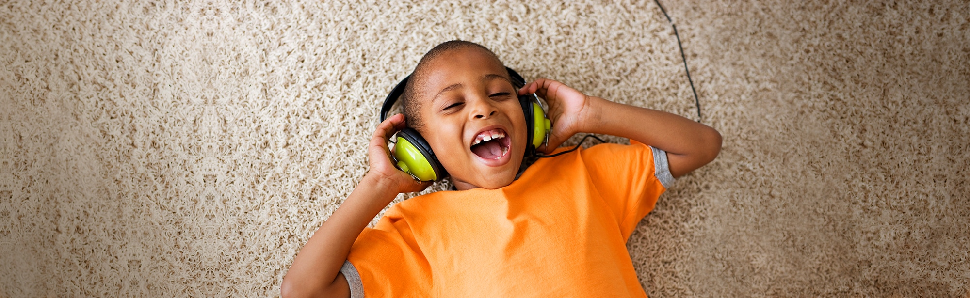 Boy smiling and listening to music